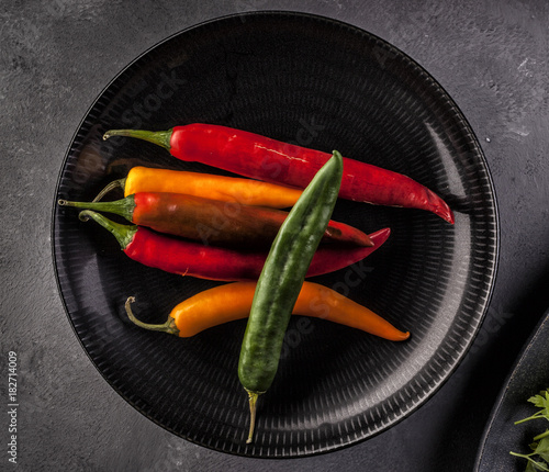 Tuinposter Hot chili peppers Red and green hot chili peppers