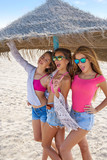 teen best friends girls under thatch umbrella - 182716651