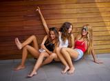 Teen best friends girls having fun falling down - 182717207