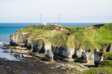 Flamborough, Yorkshire, UK. Chalk sea cliffs and a coastguard installation at Flamborough Head - 182719045