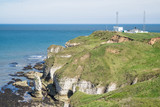 Flamborough, Yorkshire, UK. Chalk sea cliffs and a coastguard installation at Flamborough Head - 182719079