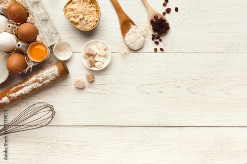 Baking background with eggs and flour on white rustic wood