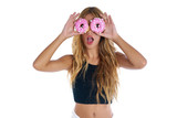Teen girl holding donuts goggles on her eyes - 182720807