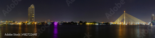 Sticker Panorama of High building and Big Suspension bridge with lighting in night time / Rama 8 bridge in night timev