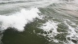 Super slow motion view from the top of the foam from the wave breaking about the shore - 182723670