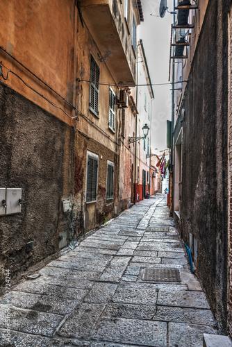 Plexiglas Smalle straatjes Narrow street in La Maddalena old town