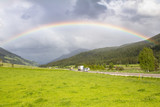 Rainbow above road and mountains - 182725615