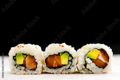 Fotobehang Sushi bar Japanese food Sushi Roll Maki of Salmon and avocado