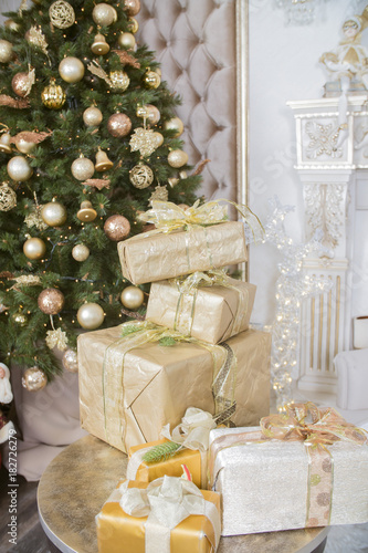 a lot of gifts for Christmas on a background of the Christmas tree