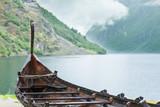 Old wooden viking boat in norwegian nature - 182741233