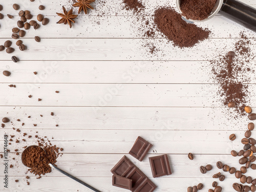 Papiers peints Café en grains Background with different coffee, coffee bean, earth, and instantly, chocolate, brown sugar and star anise, copy space, top view.