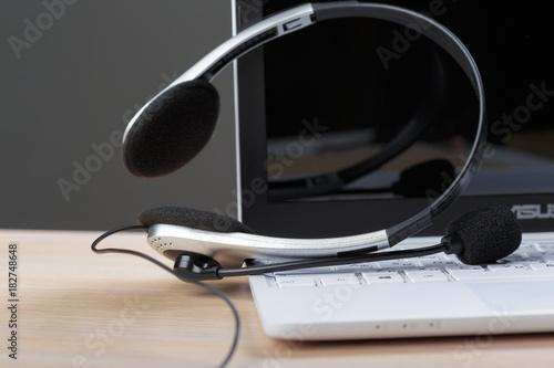 headset on keyboard computer laptop Poster