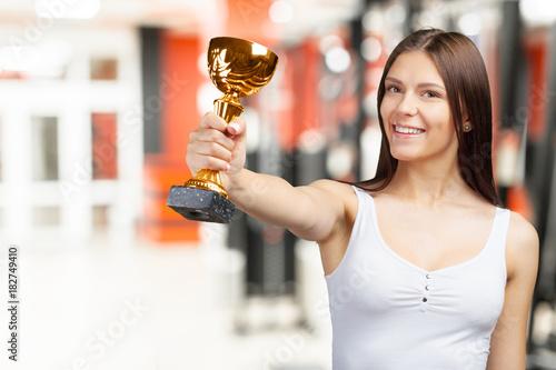 Fototapeta Happy casual woman showing her big trophy