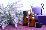 Bottles of essential oil, soap and candle with lavender - 182751845