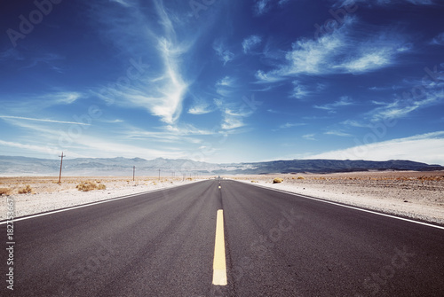 Death Valley desert road, travel concept, color toned picture, USA.