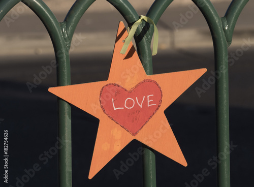 Love Star attached to a fence Poster