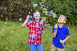 Quadro Kids playing with bubbles