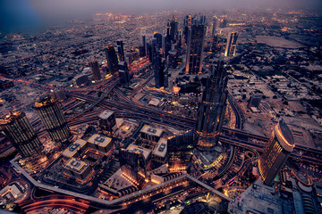 Dubai panoramic view with amazing traffic and buildings at night.