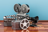 Cinema concept. Clapperboard with film reels and movie camera on the wooden floor, 3D rendering - 182768284