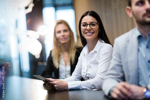 Papiers peints Kiev Portrait of smiling attractive businesswoman in office
