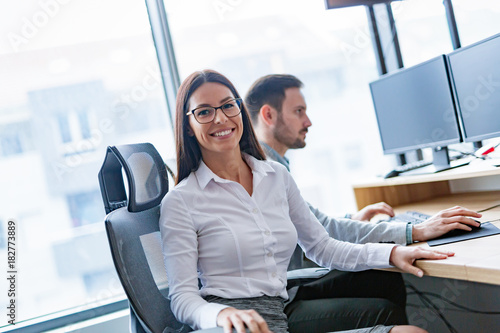Fridge magnet Portrait of smiling attractive businesswoman in office