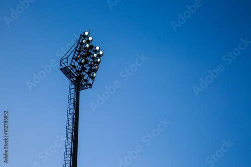Spotlight and blue sky Poster