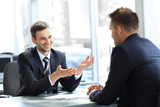 business partners talking while sitting at your Desk - 182797225