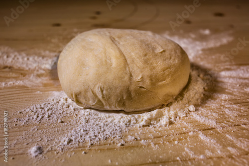 The piece of dough on the table Poster