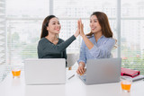 Businesspeople giving high five in the office - 182798268