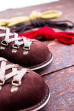 Brown man suede boots and shoelaces on wooden background. Autumn or winter shoes. Macro. - 182805266