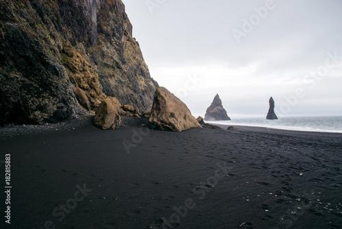 Fotobehang Lente Mountain landscape with ocean. Black beach in Iceland.