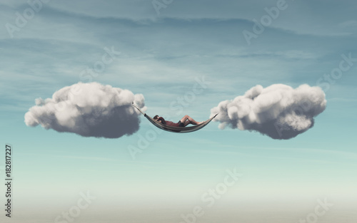 Young man relaxes in a hammock - 182817227