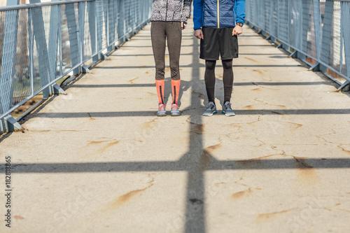 Sticker Runners Standing on Bridge
