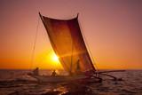 Fishermen on a catamaran at Sunset. Sri Lanka - 182825603