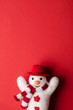 Quadro Winter festive snowman on a red background