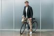 handsome young man on vintage bike indoors