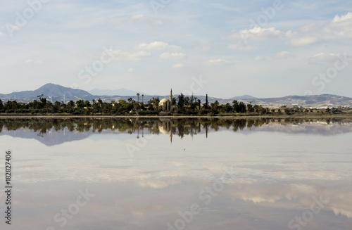 Foto op Canvas Cyprus Outdoor landscape of Hala Sultan tekke in Cyprus with water reflections and cloudy sky