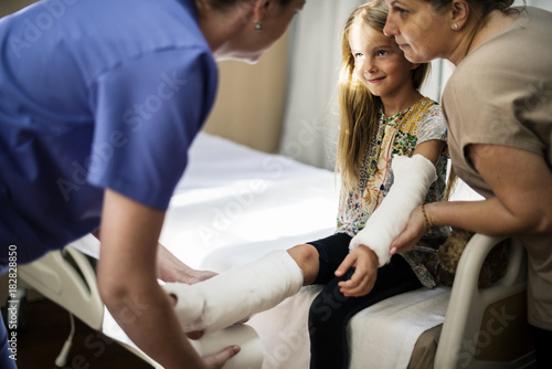 Young Caucasian girl with broken arm in plaster cast