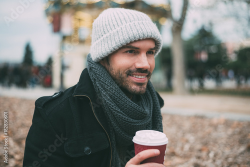 Keuken foto achterwand Madrid Young blonde man drinking coffee near the royal palace in winter .