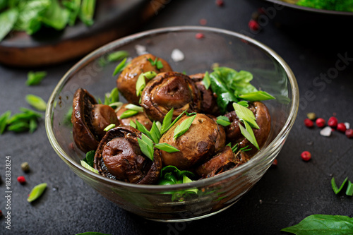 Foto op Canvas Natuur Baked mushrooms with soy sauce and herbs