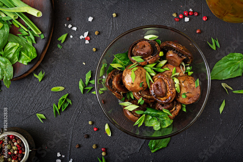 Foto op Canvas Natuur Baked mushrooms with soy sauce and herbs. Top view