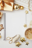 christmas workspace with notebook keyboard, sketchbook, christmas gifts and ornaments - 182836610