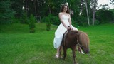 the girl is riding a pony - 182839645