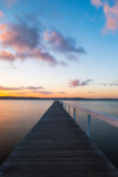 An empty view of long jetty during sunset time.