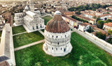 Square of Miracles in Pisa with surrounding homes. Aerial view on a summer morning - 182841814