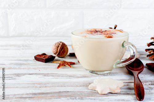 Wall mural Christmas coffee with milk, spice or hot  cocoa, pine cones