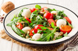 Fresh salad with arugula, cherry tomatoes, mozzarella cheese and walnuts on white wooden background. - 182852616