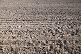 Field after autumn field work, dry soil waiting for rain - 182861627