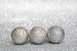 three silver balls, a new year and Christmas silver decor, write your text