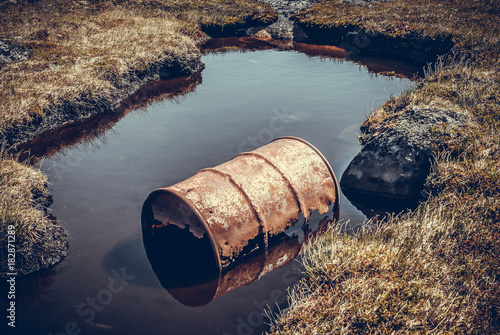 Greenland : rusted barrel in the water